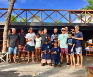 Lesi from Vunania with the kids, Rod Brooks and Dr Chris Prosser from the WSL with pro surfers & Coach Porto